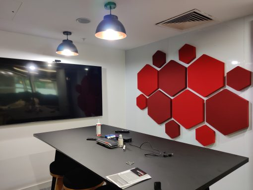 Simple hexagon office design acoustic panels in conference room shades of red